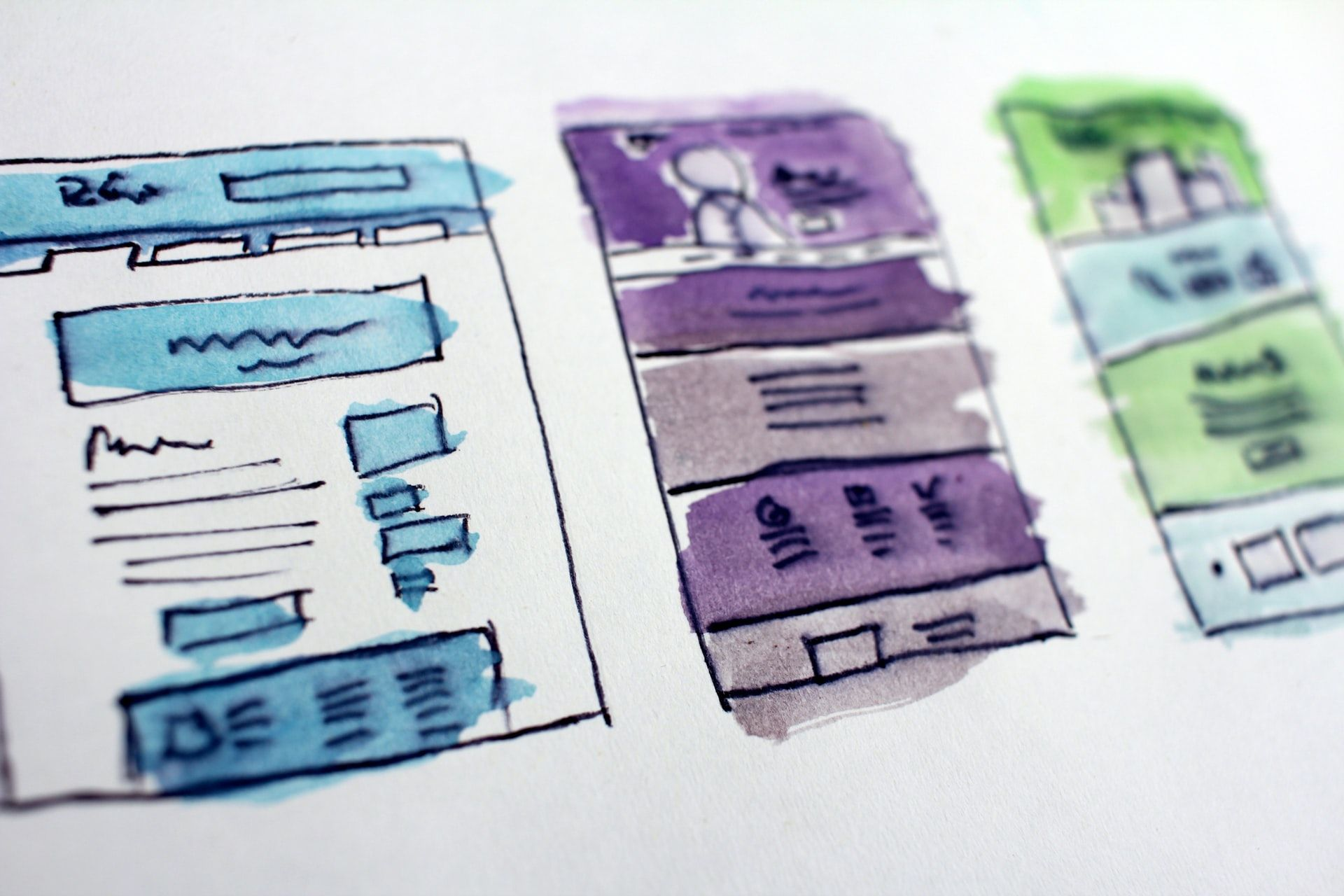 Sketched and painted app screens in three different aesthetics on white paper.