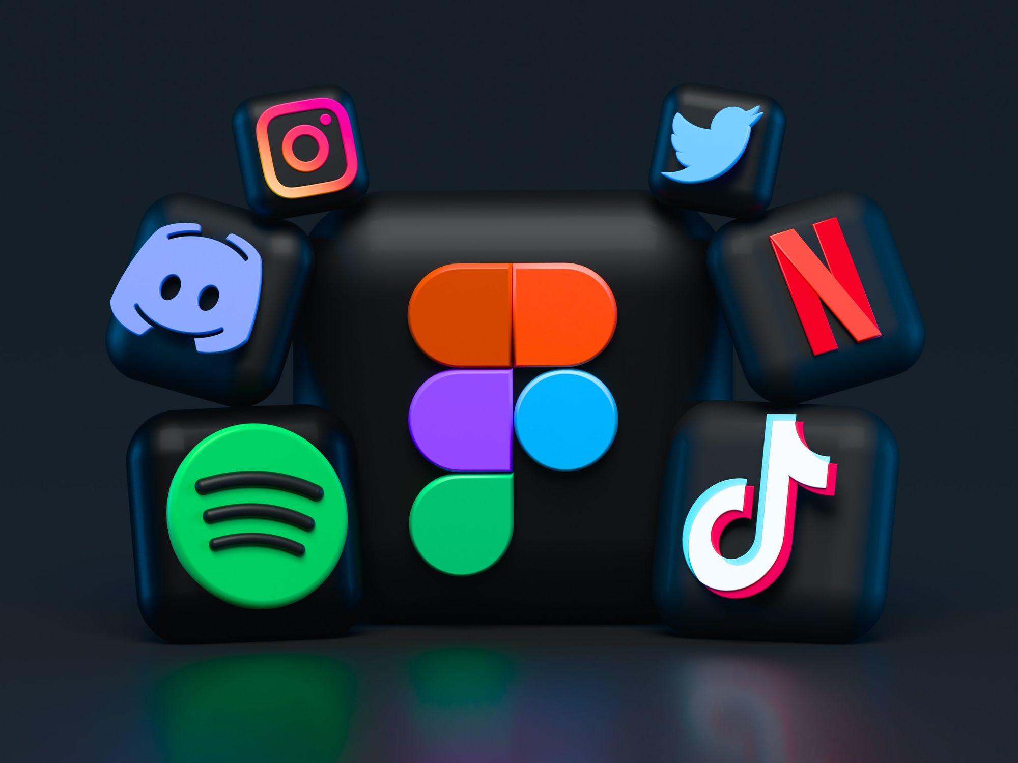 A dark frame containing icons for Spotify, Discord, Instagram, Twitter, Netflix, TikTok, etc.