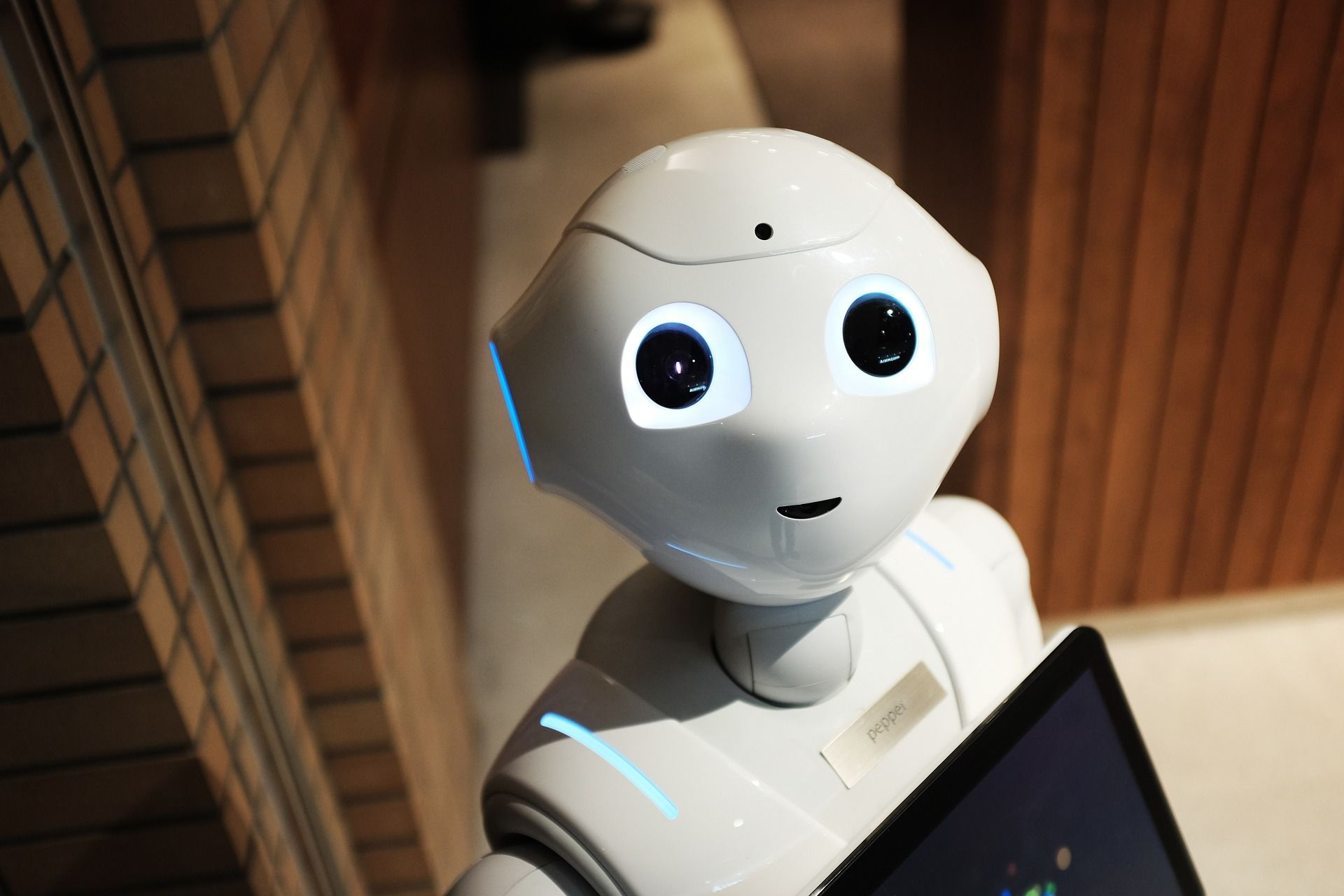 A picture of Pepper, a robot powered by AI and ML technology.
