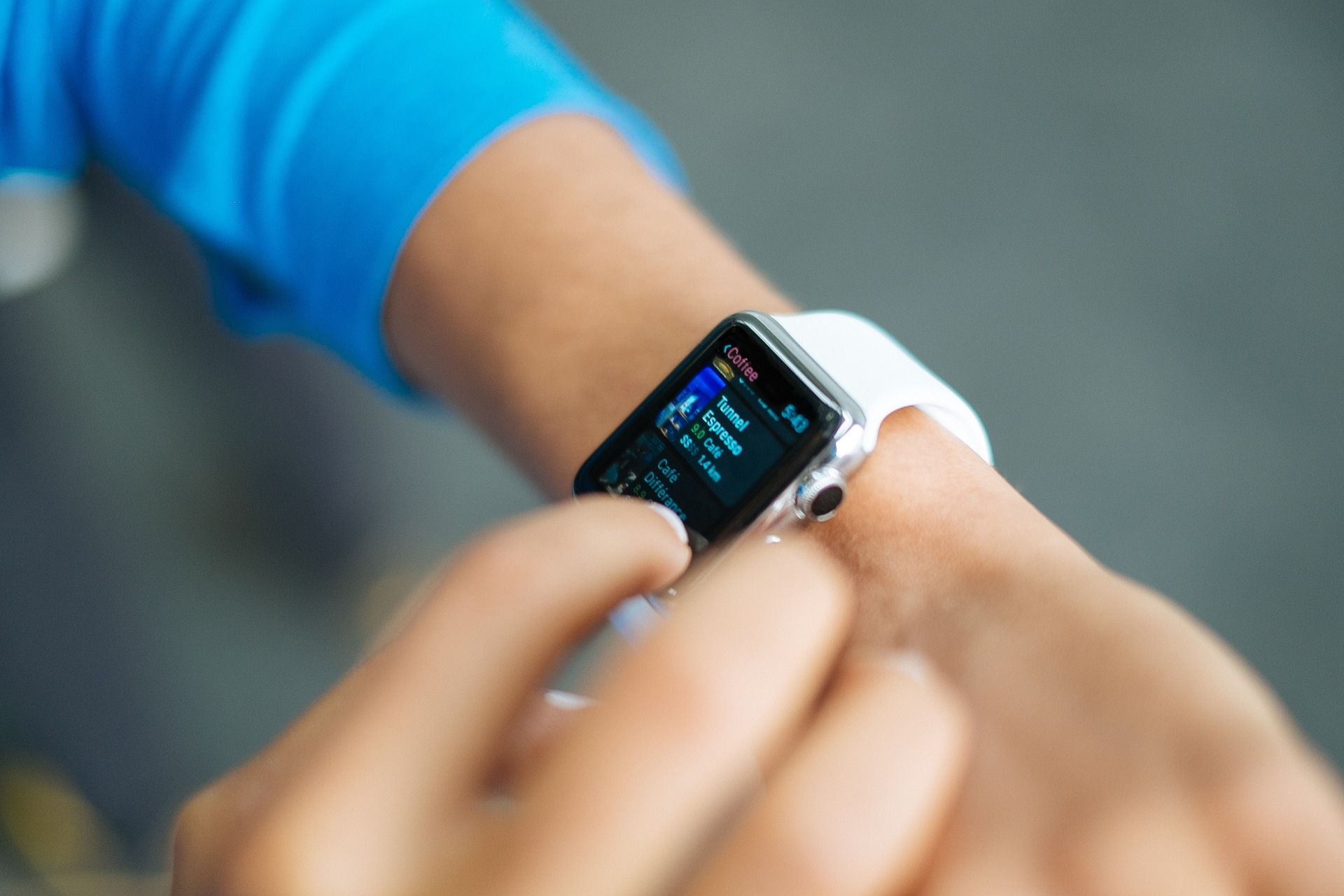 A person reviewing something on their smart watch.